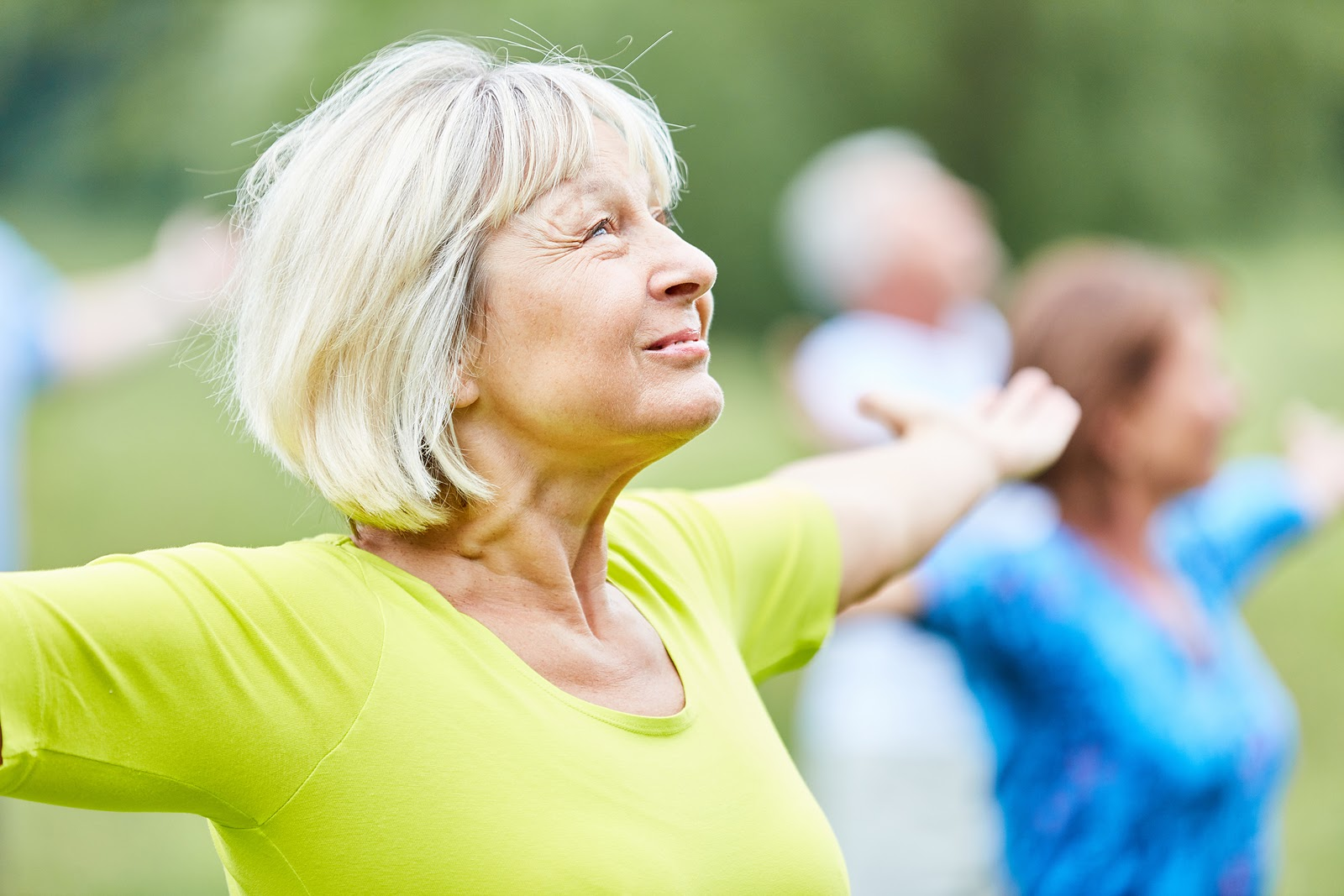 Elderly woman enjoying a group exercise call for keeping seniors active