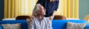 caregiver providing adult day care services to senior