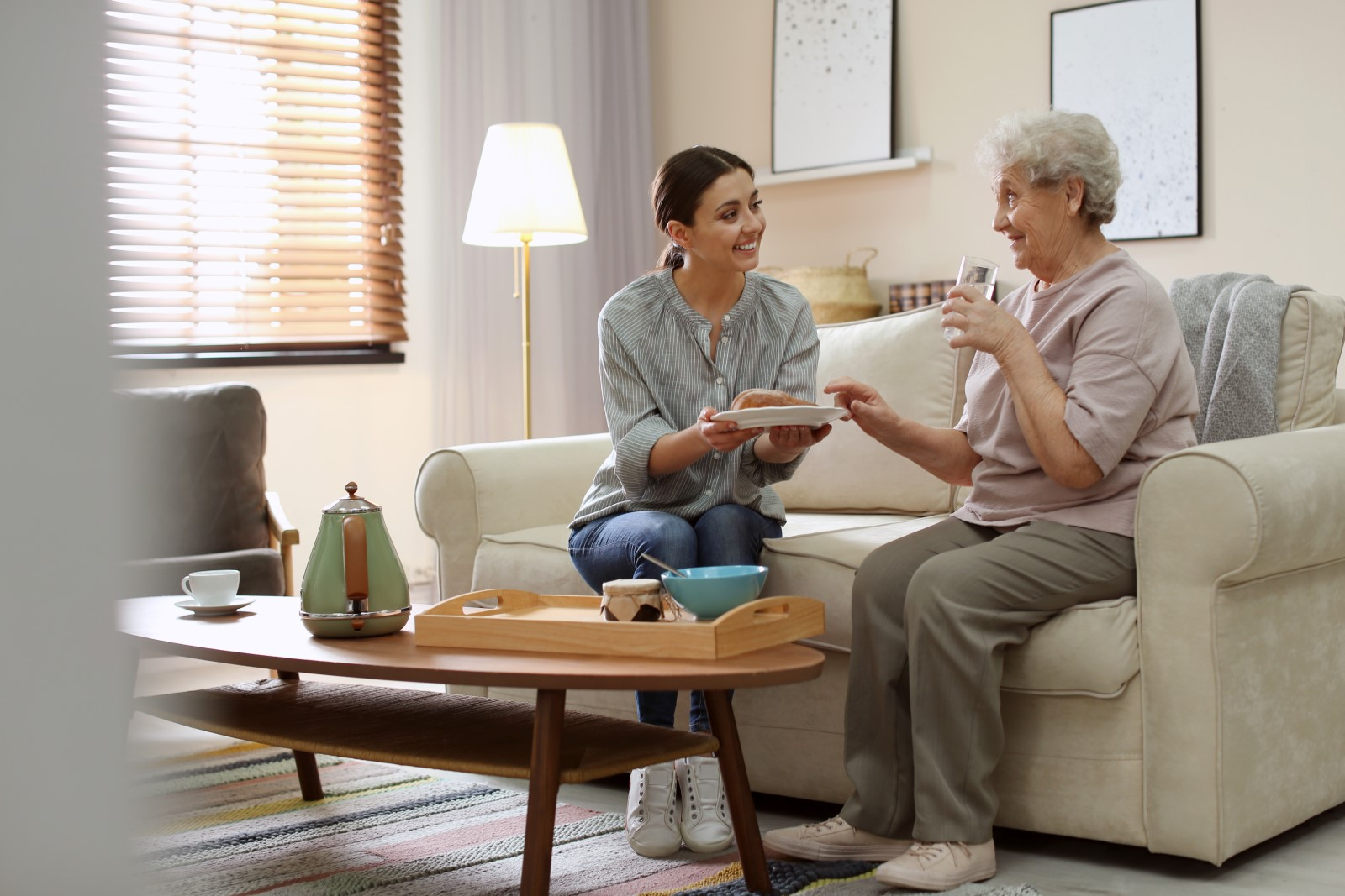 A smiling younger woman holds a smiling older woman. Learn more about Georgetown Home Care's respite home care services.