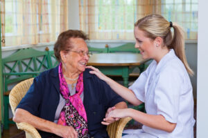 A senior woman receives home care.  Learn about temporary home care services available through Georgetown Home Care.